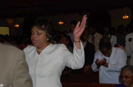 Church Member with Hands Raised